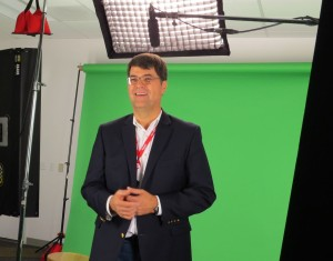 Money Minutes Producer and Director, Brian Rhea steps in as talent to check lights, audio and teleprompter just prior to Executive video capture.